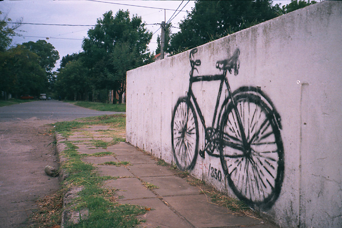 graffiti of a bicycle painted on a cement wall